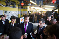 © London News Pictures. 30/01/2014. London, UK. Deputy Prime Minister NICK CLEGG (centre) talks to media during a visit to Ace Cafe in North London where he announced a multi million pound funding allocation for more electric car charging points across the country. Photo credit: Ben Cawthra/LNP
