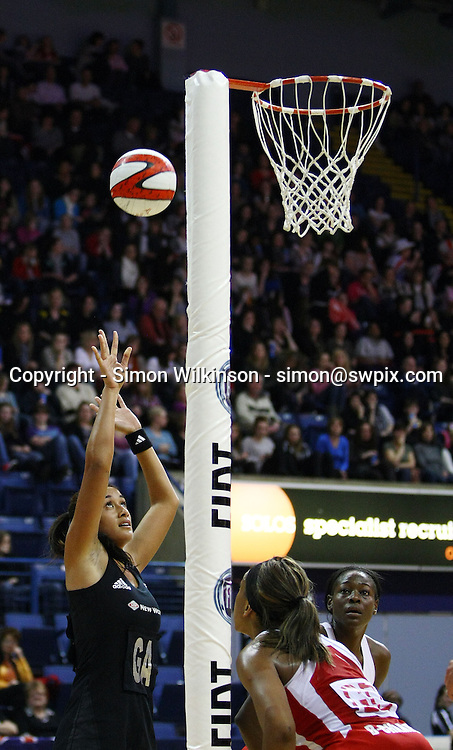 PICTURE BY VAUGHN RIDLEY/SWPIX.COM...Netball - International Netball Series - England v New Zealand - Capital FM Arena, Nottingham, England - 17/01/11...New Zealand's Maria Tutaia shoots.
