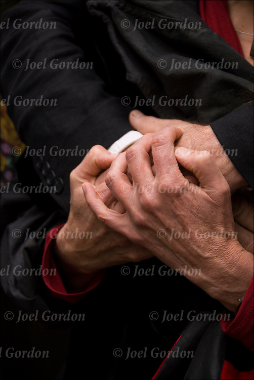 Close up of middle age couple holding hands