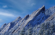 Image of snow-capped Flatirons in winter near Boulder, Colorado, American Southwest