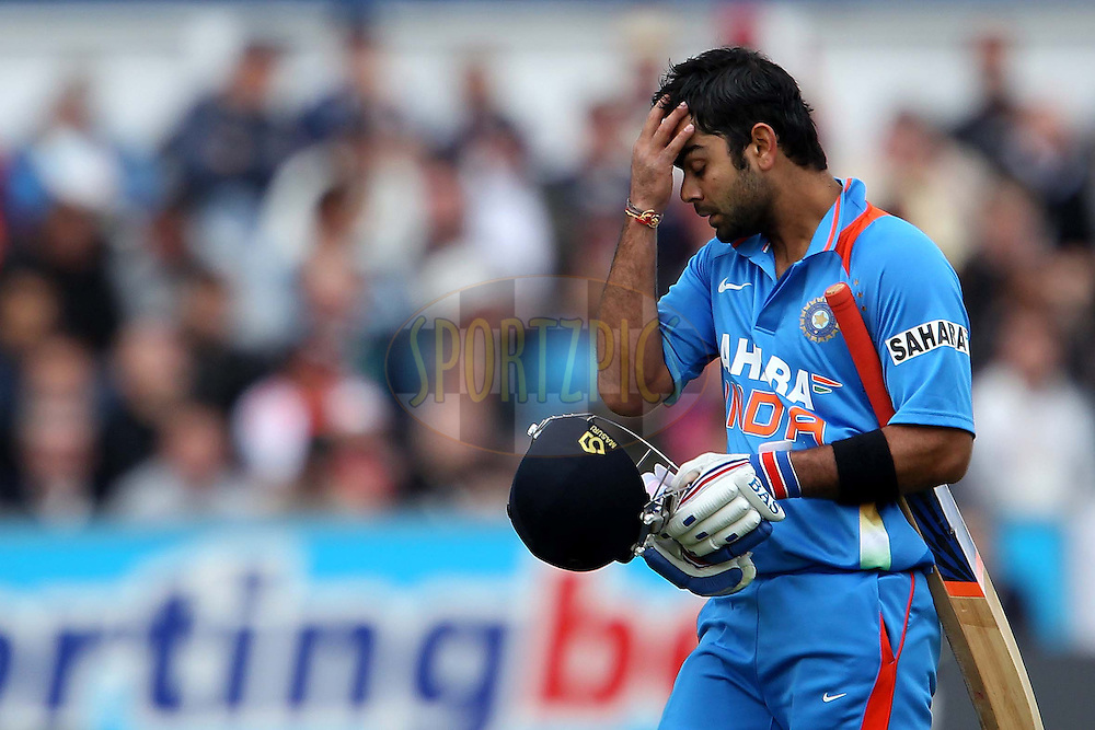 Virat Kholi departs after being bowled by Samit Patel during the first ODI ( One Day International ) match between England and India held at The Emirates International Cricket Ground in Chester-le-Street, England on the 3rd September 2011...Photo by Ron Gaunt/SPORTZPICS/BCCI