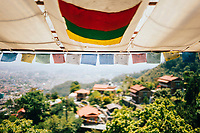 Prayer flags at Shivapuri Heights overlooking the Kathmandu Valley below.