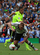 Jamie O'Hara getting fouled by Tomer Hemed during the Sky Bet Championship match between Fulham and Brighton and Hove Albion at Craven Cottage, London, England on 15 August 2015. Photo by Matthew Redman.