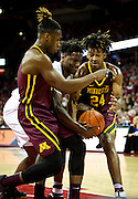 Akeem Springs, Nigel Hayes, and Eric Curry (24) fight for a loose ball during the first half of the University of Minnesota Men's Basketball game versus University of Wisconsin on March 5, 2017.