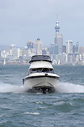 Motor launch on Auckland`s Waitamata harbour with Auckland City in the background. 17/2/2008