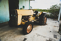 An abandoned tractor on the airstrip of Lee Stocking Cay, Exumas, Bahamas.