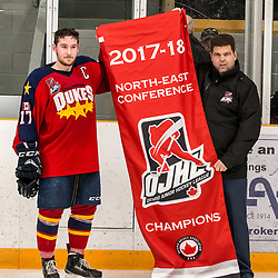 AURORA, ON - APR 8,  2018: Ontario Junior Hockey League, North East Conference Championship Series. Game five of the best of seven series between the Wellington Dukes and the Aurora Tigers. Colin Doyle #17 of the Wellington Dukes receives the North East Conference Championship banner.<br /> (Photo by Spencer Smye / OJHL Images)