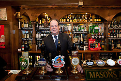 © Licensed to London News Pictures. 06/12/2012. London, UK. Road Safety Minister, Stephen Hammond stands behind the bar of the Mason's Arms pub during the launch of the 2012 Designated Drivers Campaign in London today (06/12/12). The campaign, aimed at providing free non-alcoholic drinks for designated drivers, is sponsored by soft drinks company Coca Cola and runs from 6-31 December 2012.    Photo credit: Matt Cetti-Roberts/LNP