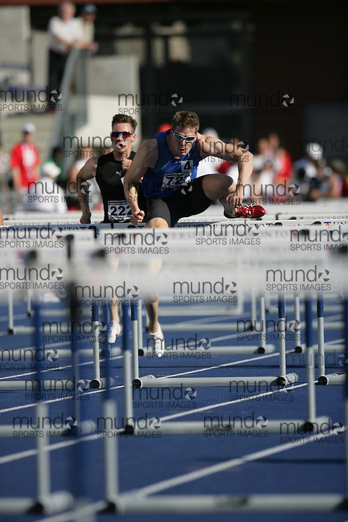 (Toronto, Ontario---26/06/09)   Joshua Gundrum competing in  110m hurdles at the 2009 Canadian National Track and field Championships. Photograph copyright Sean Burges / Mundo Sport Images, 2009. www.mundosportimages.com / www.msievents.