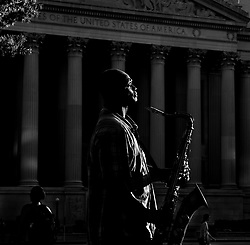 Saxophonist Darryl Leeper pauses a moment while playing on the street for some extra cash in Washington, D.C., September 2013.
