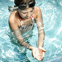 Female youth standing in pool