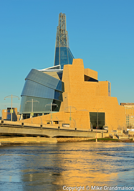 Canadian Museum for Human Rights (CMHR) and the Red River at sunrise<br /> Winnipeg<br /> Manitoba<br /> Canada