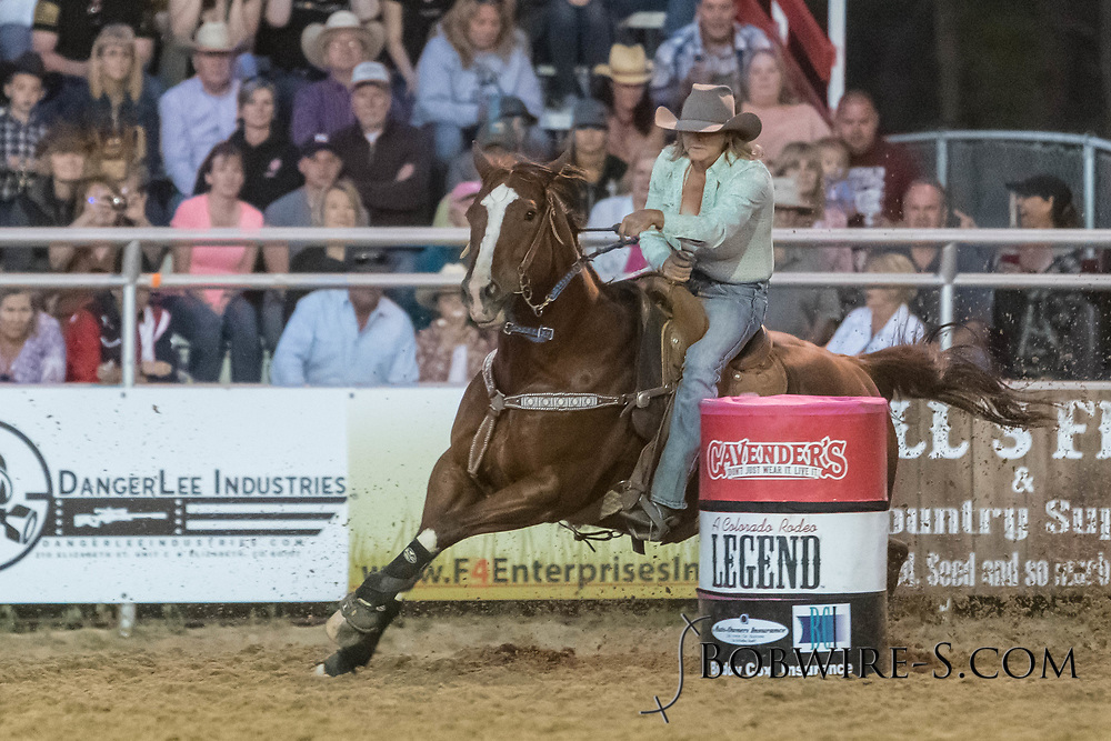Kari Boxleitner makes her run in the barrel racing during the second performance of the Elizabeth Stampede on Saturday, June 2, 2018.