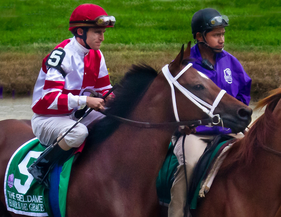 "The great jockey Ramon Dominguez, now retired due to injury, is aboard champion filly ""Havre De Grace"" in the post parade for the Beldame in 2011."