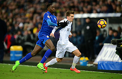 Wilfred Ndidi of Leicester City battles for the ball with Tom Carroll of Swansea City - Mandatory by-line: Alex James/JMP - 12/02/2017 - FOOTBALL - Liberty Stadium - Swansea, England - Swansea City v Leicester City - Premier League