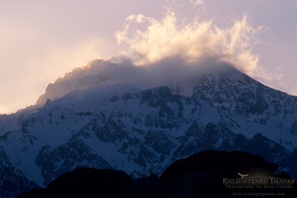 Clearing snow storm clouds over mountains in the Eastern Sierra, California