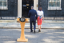 Downing Street, London, June 24th 2016. British Prime Minister David Cameron appears before the world's press gathered in Downing Street and announces that he will step aside with a new Prime Minister in place before the Party Conference, after the country votes to leave the European Union. PICTURED: David and Samantha Cameron hold hands as they head back in to 10 Downing Street following the Prime Minister's announcement that he is to step aside.