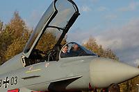 """03 NOV 2003, LAAGE/GERMANY:<br /> Gerhard Schroeder, SPD, Bundeskanzler, im Cockpit eines Eurofighter EF 2000 """"Typhoon"""", hier in der zweisitzigen Ausbildungsversion, laesst sich das neue Jagdflugzeug der Bundesluftwaffe von einem Piloten erklaeren, im Rahmen eines Besuches der Luftwaffe, Fliegerhorst Laage<br /> IMAGE: 20031103-01-042<br /> KEYWORDS: Bundeswehr, Bundesluftwaffe, Jet, Kampfflugzueg, Gerhard Schröder, Flugzeug, plane"""