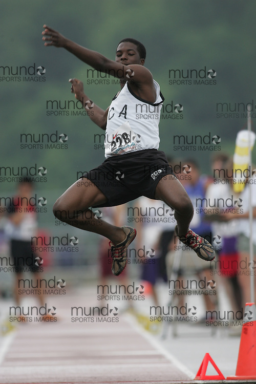 (London, Ontario}---03 June 2010) Eromosele Akhigbe of Brampton Christian - Brampton competing in the long jump at the 2010 OFSAA Ontario High School Track and Field Championships. Photograph copyright Sean Burges / Mundo Sport Images, 2010.