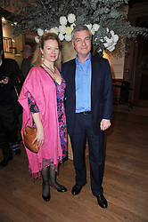 MR & MRS DAVID BURNSIDE at a private view of the Royal Academy's Modern British Sculpture exhibition held at Burlington House, Piccadilly, London on 18th January 2011.