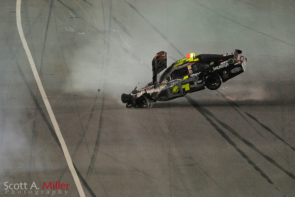 The car of Sprint Cup Series driver Jeff Gordon (24) rolls after being hit by Jimmie Johnson (48)  in Turn 4 during the Budweiser Shootout at Daytona International Speedway on Feb 18, 2012 in Daytona Beach, Fla. ..(SPECIAL TO FOX SPORTS.COM/Scott A. Miller)