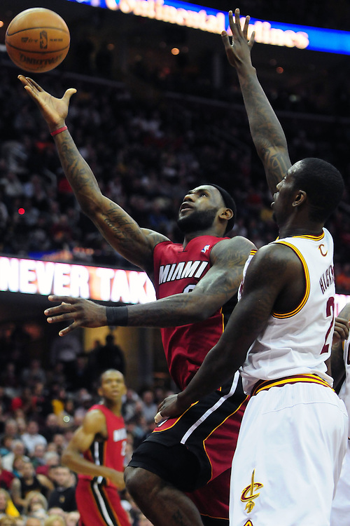 March 29, 2010; Cleveland, OH, USA; Miami Heat small forward LeBron James (6) shoots over Cleveland Cavaliers power forward J.J. Hickson (21) during the first quarter at Quicken Loans Arena. Mandatory Credit: Jason Miller-US PRESSWIRE