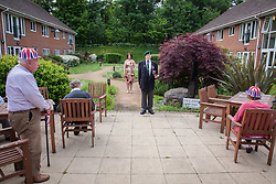 @Licensed to London News Pictures 08/05/2020. Maidstone, UK.. WO George Bradford BEM Royal Marine Commando, 40 Commando waits patiently for the bugler to sound to pay tribute to VE75 Day at Queen Elizabeth Court in the Royal British Legion village in Aylesford, Kent. RBLI also wanted to use Two Minute Silence to honour the service and sacrifice of the Second World War generation and reflect on the devastating impact Covid-19 has had on so many lives across the world.  Photo credit: Manu Palomeque/LNP