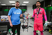 FGR secretary James Mooney and Forest Green Rovers goalkeeper Sam Russell(23) with the trophy during the Vanarama National League Play Off Final match between Tranmere Rovers and Forest Green Rovers at Wembley Stadium, London, England on 14 May 2017. Photo by Shane Healey.