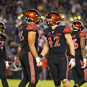 24 November 2018: San Diego State Aztecs linebacker Troy Cassidy (42) and defensive lineman Anthony Luke (45) celebrate after a defensive stop against the Hawaii Warriors. The Aztecs closed out the season with a 31-30 overtime loss to Hawaii at SDCCU Stadium.