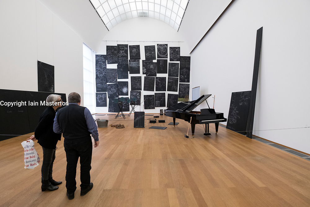 Visitors looking at sculpture Das Kapital Raum by Beuys at Hamburger Bahnhof modern art museum in Berlin, Germany