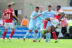 Bristol City's Jay Emmanuel-Thomas takes a shot at goal under pressure.  - Photo mandatory by-line: Dougie Allward/JMP - Tel: Mobile: 07966 386802 11/08/2013 - SPORT - FOOTBALL - Sixfields Stadium - Sixfields Stadium -  Coventry V Bristol City - Sky Bet League One