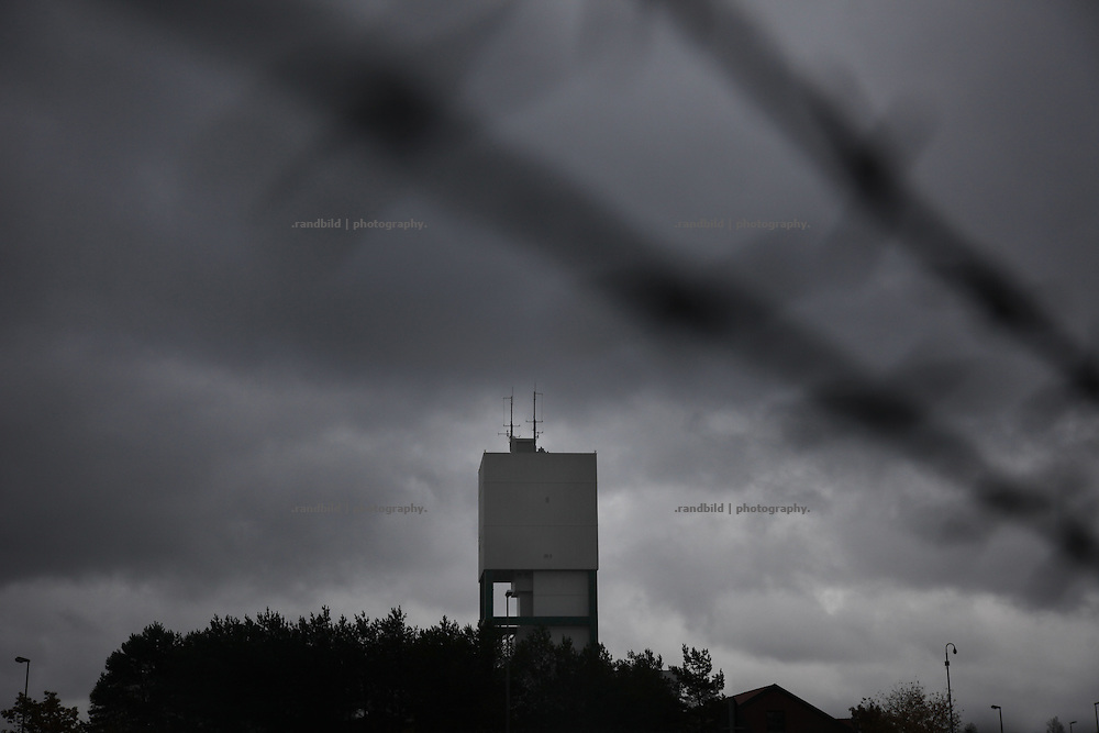 Dark clouds above the tower of well no. 1 of the possible final storage of nuclear waste in Gorleben.