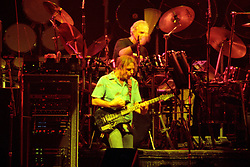 """Bob Weir and Bill Kreutzmann performing with The Grateful Dead Live at The Hampton Coliseum on 8 October 1989. One of the Eleven images included in the CD boxed set release, """"Formerly The Warlocks"""". Can be purchased individually or as part of a special limited set of all 11 in the package printed by the photographer. Choose in Cart."""