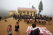 Hilltribe villages around Sapa. Adult Black Hmong taking literacy test.