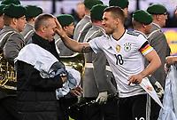 FUSSBALL  INTERNATIONAL TESTSPIEL  IN DORTMUND  22.03.2017 Deutschland - England           Lukas Podolski (Mitte) watscht Chef-Zeugwart Thomas Mai (Mitte) ab.