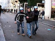 Roma 14 Dicembre 2010.<br /> Manifestazione contro il Governo Berlusconi. La polizia ferma un manifestante in via del Corso.<br /> Rome December 14, 2010.<br /> Demonstration against the Berlusconi government.