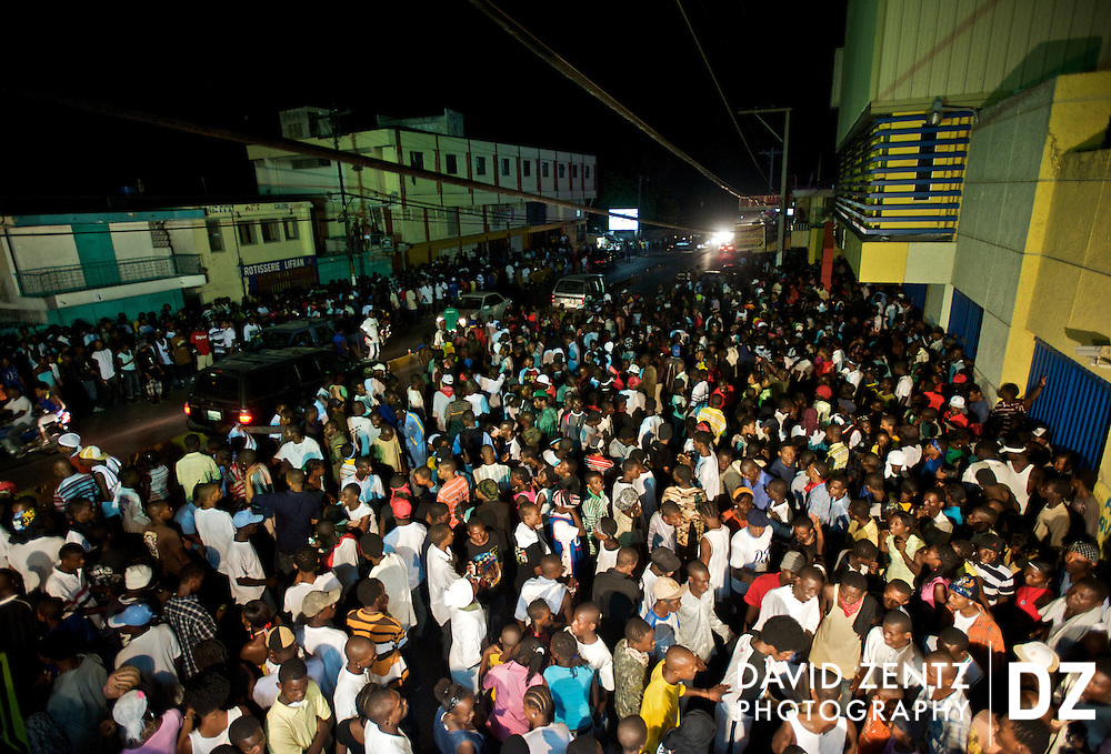 Large crowds of youths, primarily young men, gather on the streets of Port-au-Prince, Haiti, for a ti sourit, an all-night block party on July 13, 2008. The parties are popular with the younger generation and largely feature rap kreyol music.