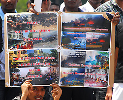 Myanmar muslims living in Malaysia protest against ethnie unrest between Buddhists and muslims in Meiklhtila Myhanmar. Anti muslims mobs rampaged though three more towns in Myhamar, hundreds died in one place and 24 orphans were killed,  Malaysia,  March 25, 2013. Photo by Imago / i-Images...UK ONLY.