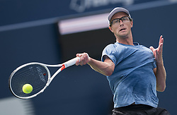 TORONTO, Aug. 7, 2018  Peter Polansky of Canada hits a return during the first round of men's singles match against Matthew Ebden of Australia at the 2018 Rogers Cup in Toronto, Canada, Aug. 6, 2018. Peter Polansky won 2-0. (Credit Image: © Xinhua via ZUMA Wire)