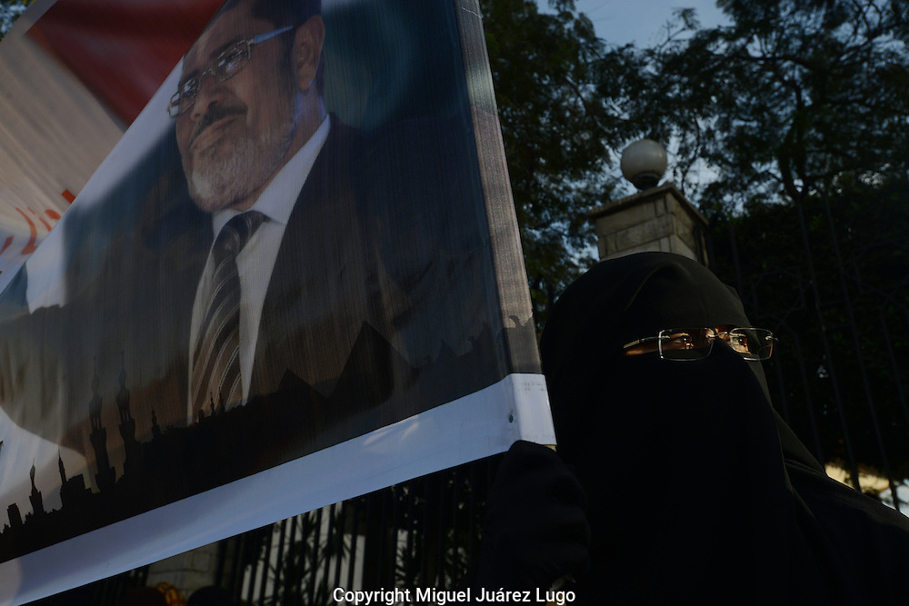Cairo, Egypt, Dec. 11, 2012-An Islamist suporter of Egyptian President Mohamed Morsi holds his poster during a rally. (Photo by Miguel Juarez Lugo)