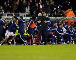 Stoke City Manager, Mark Hughes and his coaching staff celebrate Stoke City's Oussama Assaidi's winning goal - Photo mandatory by-line: Joe Meredith/JMP - Tel: Mobile: 07966 386802 07/12/2013 - SPORT - Football - Stoke-On-Trent - Britannia Stadium - Stoke City v Chelsea - Barclays Premier League