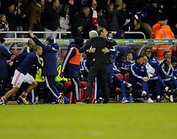 Stoke City Manager, Mark Hughes and his coaching staff celebrate Stoke City's Oussama Assaidi's winning goal - Photo mandatory by-line: Joe Meredith/JMP - Tel: Mobile: 07966 386802 07/12/2013 - SPORT - Football - Stoke-On-Trent - Britannia Stadium - Stoke City v Chelsea - Barclays Premier League