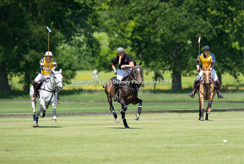 Polo action at Hurtwood Park Polo Club, Surrey on the 25th May 2014.© Credit: Leigh Dawney Photography 2014.