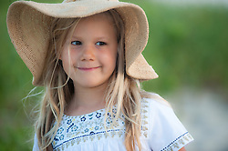adorable little girl in a sun hat