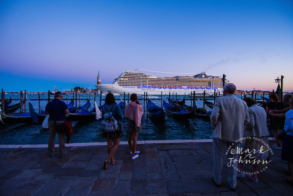 Tourists watch a cruise ship on the Grand Canal, Venice, Italy, Europe