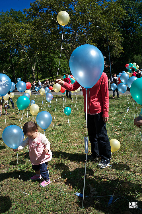Hundreds of balloons decorate a sunny morning in Central Park during the Fall.