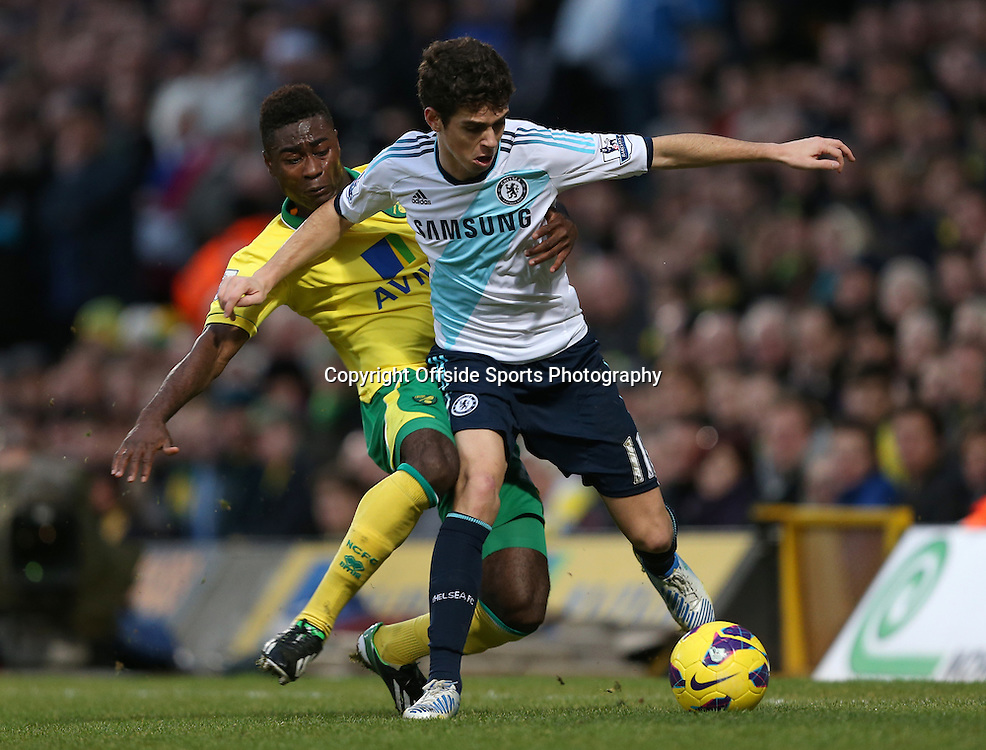 26th December 2012 - Barclays Premier League - Norwich City vs. Chelsea - Alexander Tettey of Norwich tackles Oscar of Chelsea - Photo: Simon Stacpoole / Offside.