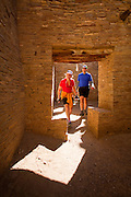 350204-1005 ~ Copyright: George H. H. Huey ~ Visitors inside Pueblo Bonito. Anasazi culture 'great house'. Chaco Culture National Historical Park, New Mexico.