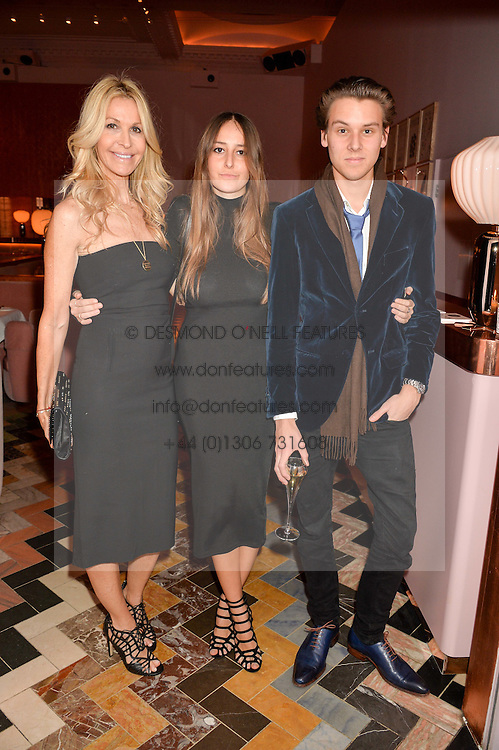 Left to right, MELISSA ODABASH, her daughter ALAIA DE SANTIS and EDOUARD REBILLY at an Evening of Riviera Inspired Glamour in aid of CLIC Sargentheld at Sketch, 9 Conduit Street, London on 25th January 2016.