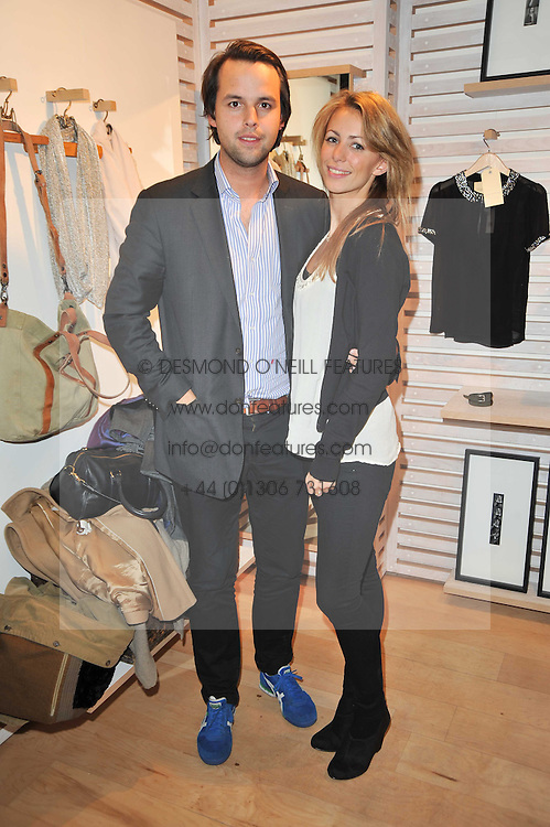 CHARLIE GILKES and ANNEKE VON TROTHA TAYLOR at the launch party for Club Monaco at Browns, 32 South Molton Street, London on 16th February 2011.